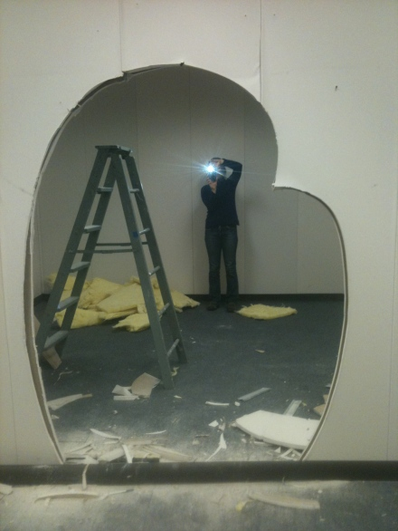 jane and i simultaneously taking photos of one another through this sweet hole that mark cut out!!